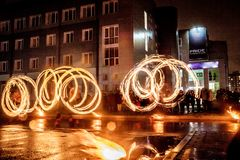Night performance fire show in front of a crowd of people stock photo