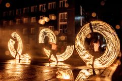 Night performance fire show in front of a crowd of people stock image