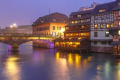 Night Petite France in Strasbourg, Alsace. Traditional Alsatian half-timbered houses and bridge in Petite France during twilight blue hour, Strasbourg, Alsace Royalty Free Stock Photography