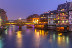 Night Petite France in Strasbourg, Alsace. Traditional Alsatian half-timbered houses and bridge in Petite France during twilight blue hour, Strasbourg, Alsace Royalty Free Stock Image
