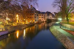 Night Petite France in Strasbourg, Alsace. Traditional Alsatian half-timbered houses and canal in Petite France during twilight blue hour, Strasbourg, Alsace Royalty Free Stock Image