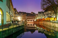 Night Petite France in Strasbourg, Alsace. Traditional Alsatian half-timbered houses with mirror reflections in Petite France during twilight blue hour Royalty Free Stock Image