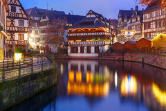 Night Petite France in Strasbourg, Alsace. Traditional Alsatian half-timbered houses with mirror reflections in Petite France during twilight blue hour Royalty Free Stock Photo