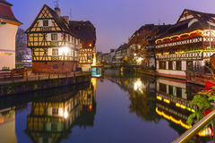 Night Petite France in Strasbourg, Alsace. Traditional Alsatian half-timbered houses with mirror reflections in Petite France during twilight blue hour decorated Royalty Free Stock Photography
