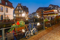 Night Petite France in Strasbourg, Alsace. Traditional Alsatian half-timbered houses with mirror reflections in Petite France during twilight blue hour decorated Royalty Free Stock Image