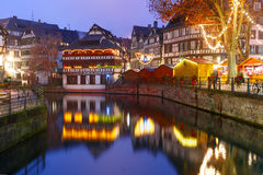 Night Petite France in Strasbourg, Alsace. Traditional Alsatian half-timbered houses with mirror reflections in Petite France during twilight blue hour Stock Photography