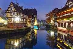 Night Petite France in Strasbourg, Alsace. Traditional Alsatian half-timbered houses with mirror reflections in Petite France during twilight blue hour decorated Royalty Free Stock Photo