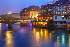 Night Petite France in Strasbourg, Alsace. Traditional Alsatian half-timbered housesand bridge in Petite France during twilight blue hour, Strasbourg, Alsace Stock Photography