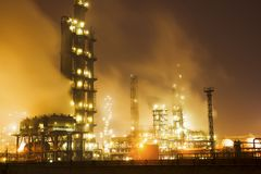 Petrochemical plant. In the night of petrochemical plant multicolored lights Royalty Free Stock Photos