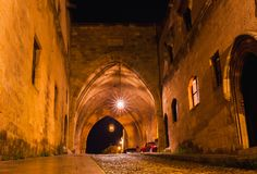 Night photo of ancient street of the Knights in Rhodes city on Rhodes island, Dodecanese, Greece. Stone walls and bright night stock images