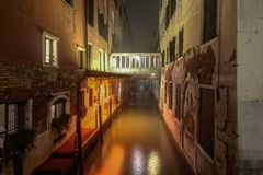 Night photo of canal in Venice, Italy. royalty free stock images