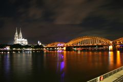 Night view - cathedral in Köln. Night photo of cathedral, railway bridge and river Rhein. Warm summer night above the city Royalty Free Stock Image