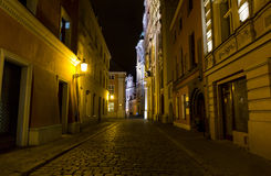 Night photo of a cobbled street in the old part of Poznan, Polan Stock Photos