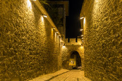 Night photo of Cobblestone street under ancient fortress entrance of old town of city of Plovdiv Royalty Free Stock Photography