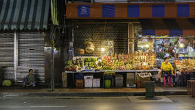 Night photo for fruiterer selling many types of fruit on china town Yaowarat Road,the main street in Chinatown. Stock Image