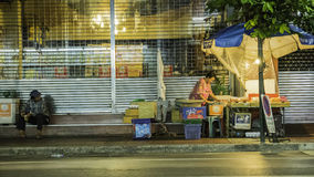 Night photo for fruiterer selling many types of fruit on china town Yaowarat Road,the main street in Chinatown. Royalty Free Stock Photos