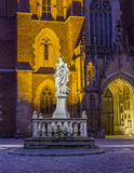 Night photo of of Holu Mother Statue in front St. John`s cathedr Stock Image