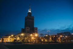 Night photo with illuminated Palace of Science and Culture. In Warsaw stock photography