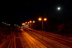 Empty road at night with orange lights royalty free stock image