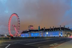 Night photo of The London Eye and County Hall from Westminster bridge, London, England, Great Brit. LONDON, ENGLAND - JUNE 16 2016: Night photo of The London Eye Stock Photo