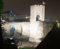 Night photo of Medieval bridge with city gate. Besalu, Catalonia Stock Images