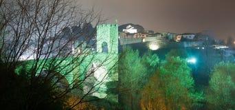 Night photo of Medieval bridge with city gate. Besalu, Catalonia Stock Photos