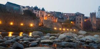 Night photo of Medieval bridge with city gate. Besalu, Catalonia Royalty Free Stock Image