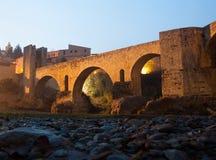 Night photo of Medieval bridge with city gate. Besalu, Catalonia Royalty Free Stock Photo