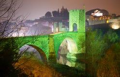 Night photo of medieval bridge over river at Besalu Stock Photos