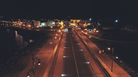 Night photo of Nesebar`s old city taken with drone. Showing the beauty of the lights in the night. The dark sea is calm in the hot august night stock images