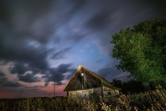 Night photo of the old abandoned wooden building under the starry sky Royalty Free Stock Photos