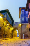 Night photo of old houes and ancient fortress entrance of old town of  Plovdiv, Bulgaria Royalty Free Stock Photo