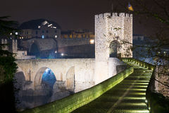 Night photo of old medieval stone bridge with gate Stock Image