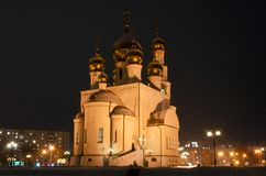 Night photo of an orthodox cathedral. Golden domes in the light of street lamps. Russia. Abakan.  royalty free stock photos
