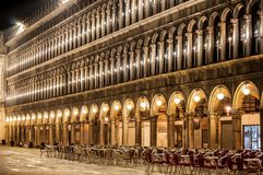 Piazza San Marco Venice Italy at night with tables and chairs stock photo