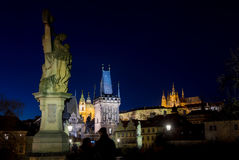 Night photo of Prague Charles Bridge and powder tower Royalty Free Stock Photography