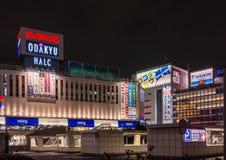 Night photo of Shinjuku square. Tokyo, Japan - September 29, 2016: Night picture of the neon lights around Shinjuku square and bus station. Black starless sky Royalty Free Stock Photography