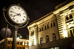 Night photo of the street and facade of the illuminated building Royalty Free Stock Images