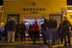 NIGHT PHOTO OF A STREET LOCAL MARKET WITH PEOPLE royalty free stock photos