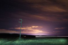 Night photo taken at Patagonia Argentina. Night, photography, patagonia, dark, sky, stars, clouds, fence, dirt, electricity, pole, route, long, exposure stock photo