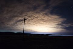 Night photo taken at Patagonia Argentina. Night, photography, patagonia, dark, sky, stars, clouds, fence, dirt, electricity, pole, route, long, exposure royalty free stock photos