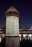 Night photo of tower of Chapel Bridge in City of Lucern, Canton of Lucerne, Switzerland Stock Photo