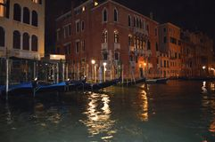 Night Photograph Of A Full Jetty Of Gondolas On The Grand Canal Of Venice From The Adriatic Sea. Travel, Holidays, Architecture. stock image