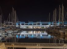 NIGHT PHOTOGRAPH OF A PORT OF BOATS AND A PUB BAR stock photography