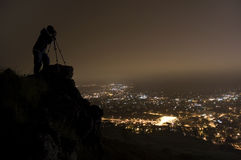 Night Photographer. Photographer on a cliff at night Royalty Free Stock Photos