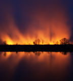 Night photography burning meadows Stock Photography