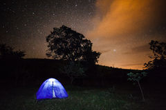 Night Photography - A Camping tent under starry sky. Stock Image
