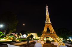 Night photography of Eiffel tower at miniature park is an open space that displays miniature buildings and models. PATTAYA CITY, CHONBURI PROVINCE, THAILAND stock photos