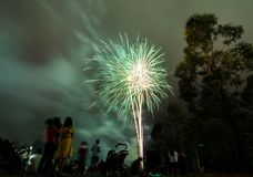 Night photography of fireworks for new year 2018 celebration above people at Parramatta park, Sydney, Australia. A Night photography of fireworks for new year stock image