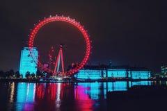 The London eye at night. Night photography of the London eye and park across the river in London England Royalty Free Stock Photos